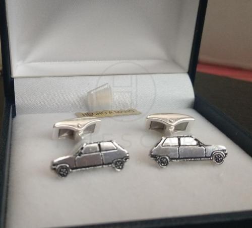 gemelos coches de plata